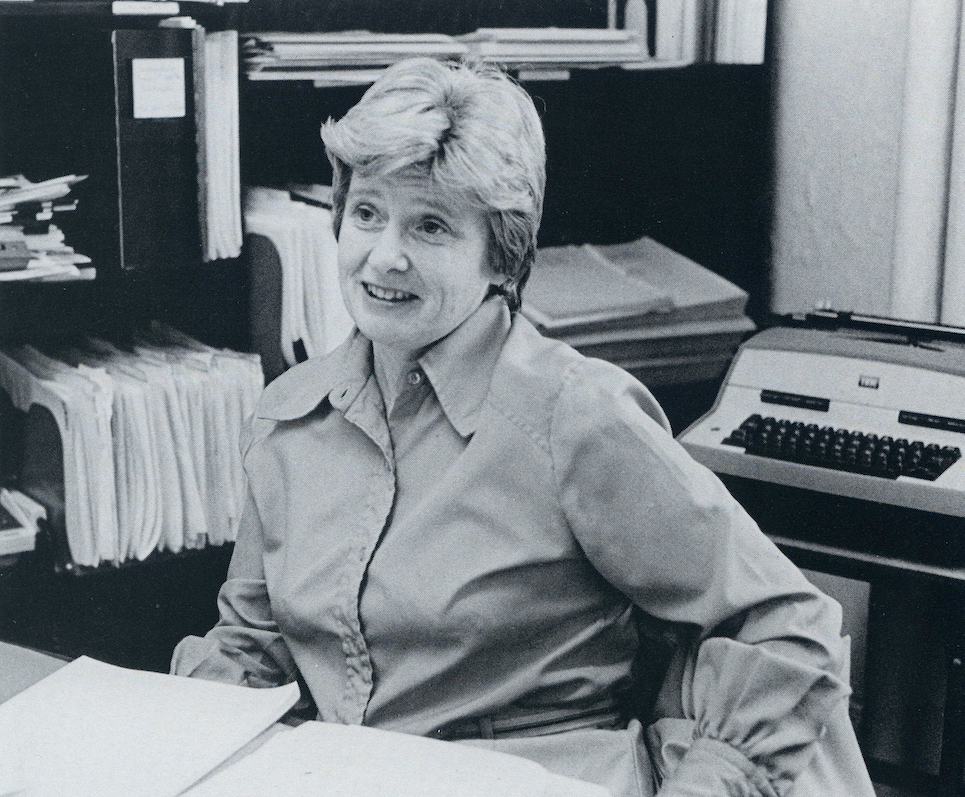 black and white image of Professor Dorothy Brown seated at a desk in an office.